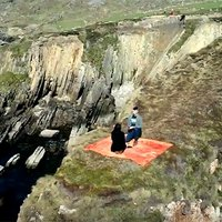 High on an Irish Cliffside, This Couple Experiences a Proposal Like No Other